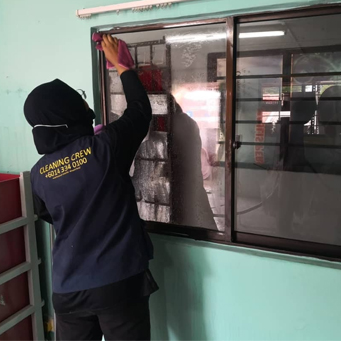cleaning-services-company-woman-cleaning-window